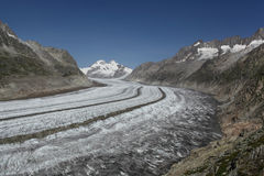 View over Aletsch glacier with a blue sky. Royalty Free Stock Photography