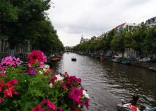 View Over Amsterdam Canal with Flowers stock image