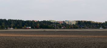 View over arable land. On high houses Royalty Free Stock Photography