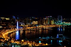 View over Baku Bulvar and the Caspian Sea at night Stock Photos