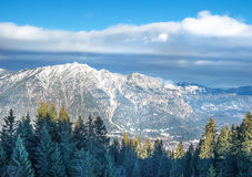 The view over the Bavarian Alpine slopes covered with snow from Royalty Free Stock Image