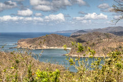 View over the bay of San Juan del Sur, Nicaragua. View over the beautiful bay of San Juan del Sur in Nicaragua with boats on the water and mountains in the Royalty Free Stock Photos
