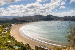 View over the bay of San Juan del Sur, Nicaragua. View over the beautiful bay of San Juan del Sur in Nicaragua with boats on the water and mountains in the Royalty Free Stock Image