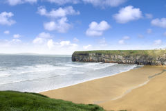 View over the beach and cliffs in Ballybunion. Beautiful view over the Ballybunion beach and cliffs on the Atlantic coast in Ireland Stock Images