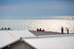 View over beach hut roofs to the beach Royalty Free Stock Photos