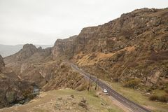 View over beautiful canyon from the edge of a road Royalty Free Stock Photo