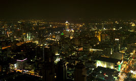 A view over the big asian city of Bangkok , Thailand at nighttim. E when the tall skyscrapers are illuminated Royalty Free Stock Photo
