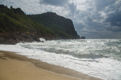 View over the blue stormy sea, nd castle hill in Alanya, Kleopatra beach Mediterranean Turkey.  stock image