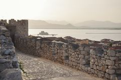 View over Bourtzi fortress from the upper castle of the Nafplio town stock photography
