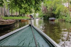 Boat view in rural town canal in North Holland royalty free stock photo