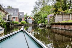 Boat view of rural canal town in North Holland stock image