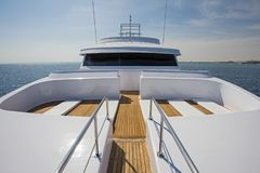 View over the bow over a large luxury motor yacht. View over the bow of a large luxury motor yacht on tropical open ocean with bridge Stock Image
