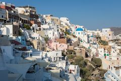 View over the buildings in the cliffside of Oia, Santorini. stock images