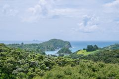 View over bush to Tutukaka Harbour and The Poor Knights Islands,. View over green bush landscape to Tutukaka Harbour and The Poor Knights Islands, Northland, New Stock Photos
