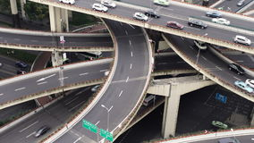View over busy elevated road junction & skyline, Shanghai stock video footage