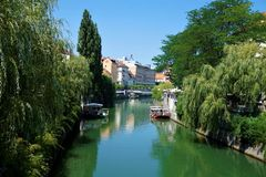 View over calm Ljubljanica river in the city centre of Ljubljana. View over calm Ljubljanica river in the city center of Ljubljana, Slovenia Royalty Free Stock Photography