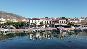 View Across Galaxidi Harbour To Historic Buildings, Greece. View over calm sea water in Galaxidi small harbour to original historic buildings and docked stock video footage