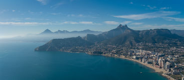 View over Calpe Calp town, Spain. Shot from the Penon   Ifach. Rock, overlooking the coast, the harbor and Sierra de Bernia mountains Stock Photography