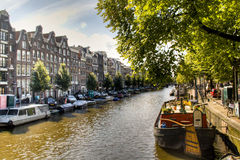 View over a canal in Amsterdam. A canal with typical houses and boats in Amsterdam, Netherlands Royalty Free Stock Photo