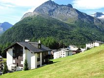 View over chalets to mountains in Saas Fee, Switzerland stock image
