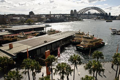 View over Circular Quay to harbour bridge. View from Cahill walkway overlooking circular quay to the habour bridge on Sydney harbour. Copyspace stock photography