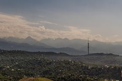 View over city towards Mountains beyond, with Communications Tow Stock Photos
