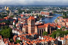View Over City Of Gdansk In Poland. Gdansk city from above in Poland, view over the Old Town with St. John Church and historic red tiled houses Royalty Free Stock Photography