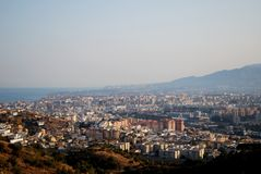 View over city rooftops, Malaga, Andalusia, Spain. City seen at sunset from the Montanas de Malaga, Malaga, Malaga Province, Andalusia, Spain, Western Europe Royalty Free Stock Photos