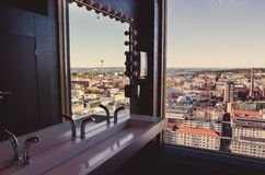 A view over the city of Tampere, Finland. From the window of a restaurant restroom Stock Image