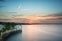 View over cliffs bay at sunset with yachts in bay Stock Image