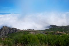 View over the clouds from the mountain Pico do Arieiro on the Portuguese island of Madeira. Amazing view over the clouds from the mountain Pico do Arieiro on the royalty free stock images