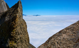 View over the clouds with rocks in the foreground. Moro Rock, Sequoia National Park, California, USA royalty free stock photography