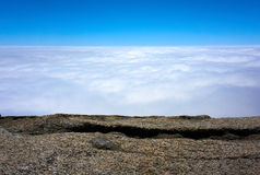 View over the clouds with rocks in the foreground. Moro Rock, Sequoia National Park, California, USA royalty free stock photos