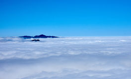 View over the clouds with tree tops in the middle. – Moro Rock, Sequoia National Park, California, USA stock photography