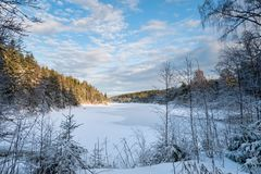View over the cold snowy lake in evening light Stock Photos