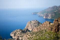 View over Delik Deniz bay in Gazipasha Turkey. View over Delik Deniz bay in Gazipasha Alanya Turkey with rocks descending to sea bays and medieval castle on the Royalty Free Stock Photography