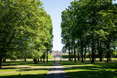 View over Drottningholm Palace from an alley in the park on a sunny day Stock Image