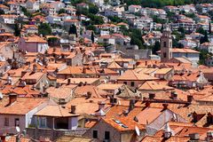 View over the roofs of Dubrovnik old town. View over Dubrovnik old town from Croatia. All the roofs are made of classic brick-red tiles Royalty Free Stock Photo
