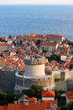 Old town of Dubrovnik near the sea, big tower. View over Dubrovnik old town from Croatia, surrounded by the blue Mediterranean Sea royalty free stock photos