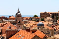 Old town of Dubrovnik near the sea, church towers. View over Dubrovnik old town from Croatia, surrounded by the blue Mediterranean Sea stock photos