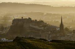 View Over Edinburgh Castle at Sunset. Hazy view over Edinburgh as the sun sets royalty free stock photos