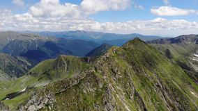 View over the Fagaras Mountains.  Combined motion. It includes the peaks Vistea Mare and Moldoveanu - Romania stock video