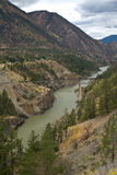 View over the Fraser Canyon, train bridge and the town of Lillooet Royalty Free Stock Image