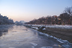 View over frozen Dambovita river and Unirii Boulevard towards the Parliament building Royalty Free Stock Photo