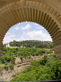 View over generalife gardens though arch stock photography