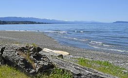 Qualicum Beach, Vancouver Island. View over the Georgia Strait from Qualicum Beach on a sunny day with blue sky, Vancouver Island British Columbia Canada Royalty Free Stock Images