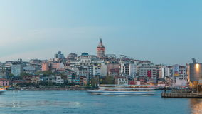 View over golden horn bay on the galata tower and its neighborhood day to night timelapse in Istanbul. stock video