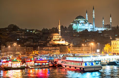 View over Golden Horn in Istanbul on night. Fishermen's boats in harbour of Eminonu on Golden Horn, Bosporus, in Istanbul, with Suleymanie mosque in background stock photography