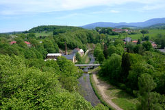 View over green hills village. And river Stock Photography
