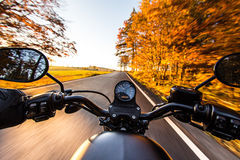 The view over the handlebars of motorcycle Stock Images